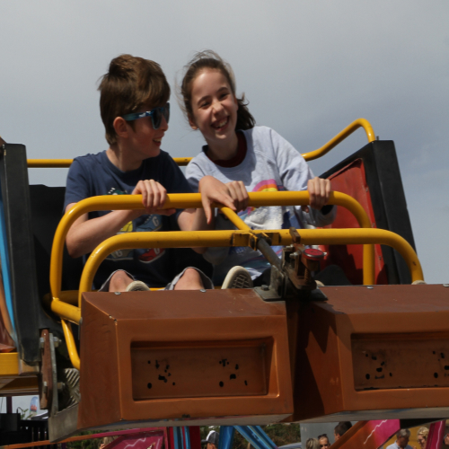 Image of kids on a fairground ride